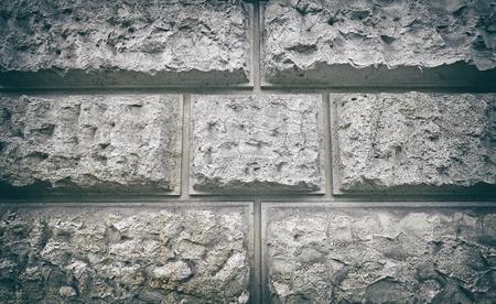 Vintage stylized porous block wall, grunge background.