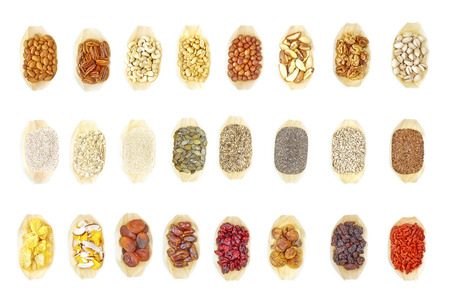 Super food selection in wooden bowls on white background, view from above.