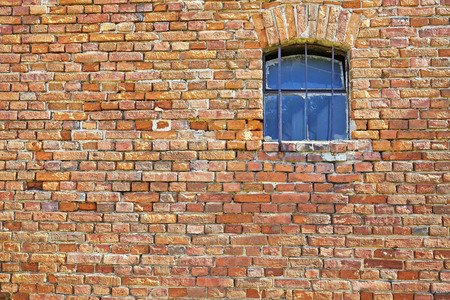 brick: Old brick wall with a small window. Stock Photo