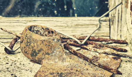 Retro toned old rusty tools, grunge background, shallow depth of field. Stock Photo