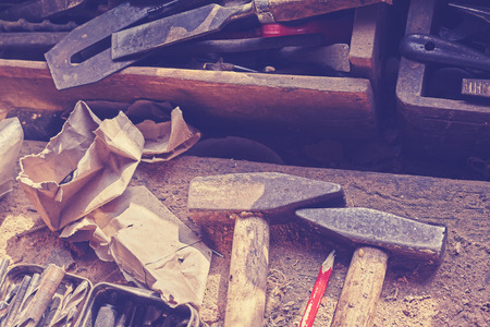 joinery: Retro toned old tools on dusty wooden table in a joinery. Stock Photo