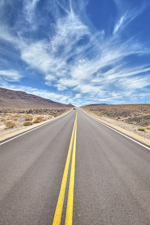 Desert road in Death Valley, travel concept, USA.