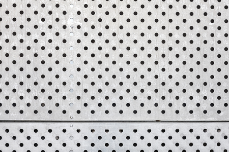aluminium wallpaper: Perforated silver metal surface, industrial background.