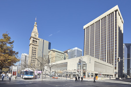 denver buildings: Denver, USA - November 4, 2016: 16th Street Mall, famous commercial pedestrian and free shuttle bus street, where numerous shops, restaurants and cafes can be found on 1.25 miles long boulevard. Editorial