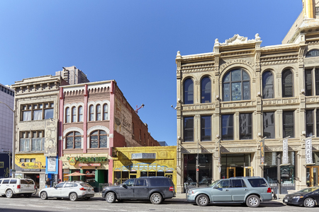 curtis: Denver, USA - November 4, 2016: Buildings along Champa St. in Curtis Park, Denvers oldest district. Established in Colorado Gold Rush era, city population rose from 4,759 in 1870 to 106,713 in 1890.