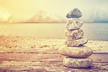 Vintage toned stack of stones, balance and harmony concept, Grand Teton National Park, Wyoming, USA. Stock Photo