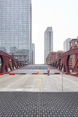 movable bridge: Chicago, USA - October 15, 2016: An unidentified man supervising the opening of movable bridge.