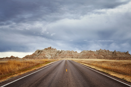 Scenic road in Badlands National Park, vacation background, South Dakota, USA.