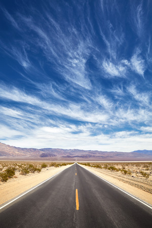 Endless desert road, Death Valley, California, USA. Stock Photo
