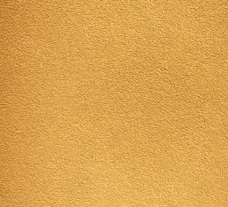 Yellow rugged plaster wall, texture or background.