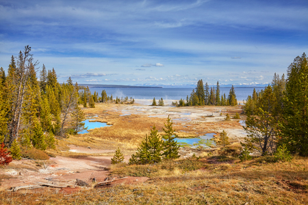 Autumn landscape with hot springs and geysers in Yellowstone National Park, Wyoming, USA.
