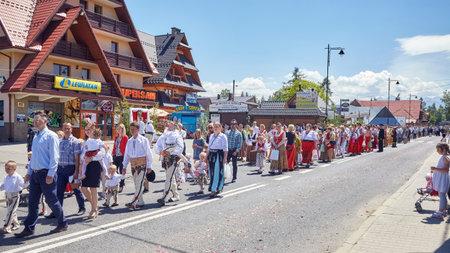 mountainous: Bialka Tatrzanska, Poland - June 15, 2017: Corpus Christi religious procession through a main street of Bialka Tatrzanska, mountainous village close to the border with Slovakia.