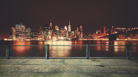 applied: Promenade with view of Manhattan skyline at night, color toning applied, New York City, USA.