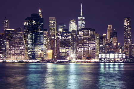 Manhattan skyline at night, color toning applied, New York City, USA.