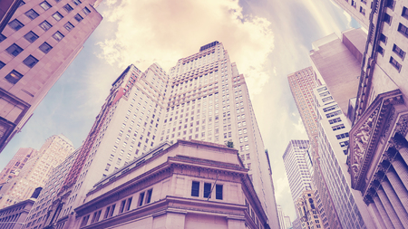 Vintage stylized Wall Street in New York City, financial capital of the world, USA.