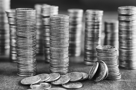 silver coins: Black and white picture of coins stacks, shallow depth of field. Stock Photo