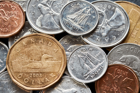 Close up picture of Canadian dollar coins, shallow depth of field.
