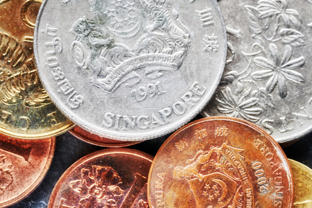 Close up picture of Singapore dollar coins, shallow depth of field.