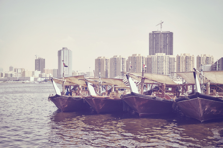 Fishing boats at Ajman fish market pier, color toning applied, United Arab Emirates. Stock Photo - 84980059