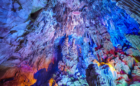 The Reed Flute Cave, natural limestone cave with multicolored lighting in Guilin, Guangxi, China.