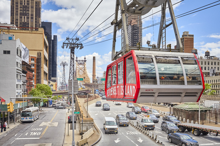 New York, USA - May 26, 2017: Cable car arrives at Manhattan station. The tram connects Roosevelt Island to the Upper East Side of Manhattan.