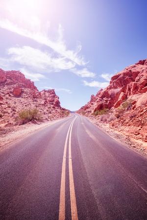 Desert road, travel adventure concept, PANTONE Ultra Violet color toned image, Nevada, USA.