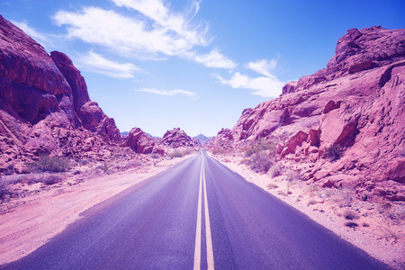 Color toned desert canyon road, travel adventure concept,  Nevada, USA. Stock Photo