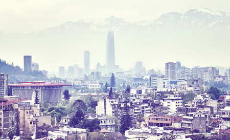 Color toned picture of Santiago de Chile downtown covered by smog, Chile.