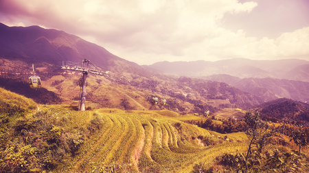 Cable car above the Longji Rice terraces (Dragons Backbone) in Longsheng County, color toned picture, China.