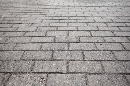 Picture of a paved street, selective focus.