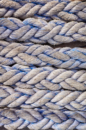 Close up picture ofold frayed boat ropes, abstract background or texture.