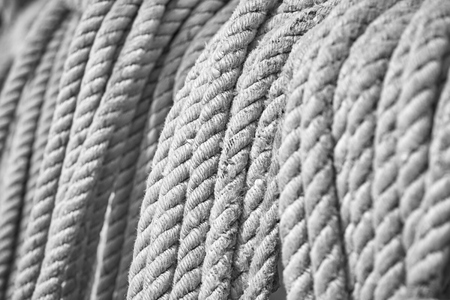 Black and white picture of old boat ropes, selective focus, nautical background. 版權商用圖片