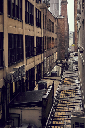 Retro toned old industrial buildings in New York on a rainy day, USA.