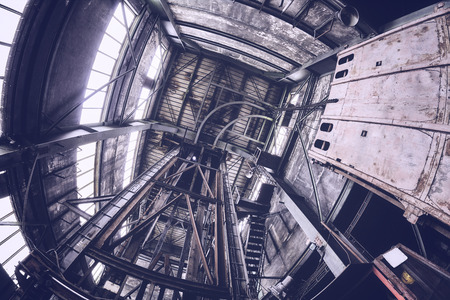 Old abandoned industrial mine interior, color toning applied.