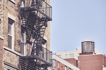 Old building fire escape, retro color toning applied, New York City, USA. Stock fotó