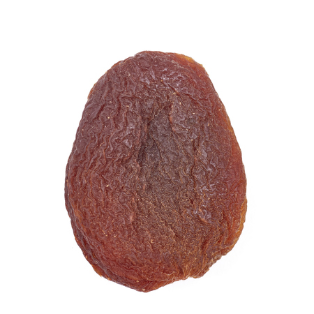 Close up picture of a naturally dried apricot isolated on a white background.