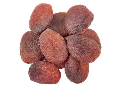 Naturally dried apricots isolated on a white background, selective focus.