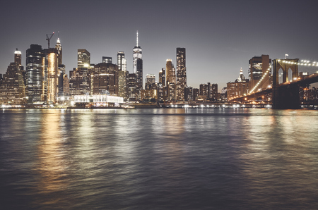 New York City skyline at night, color toned picture, USA. 免版税图像