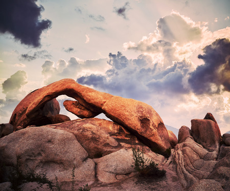 Arch Rock in Joshua Tree National Park at sunset, color toned picture, California, USA.