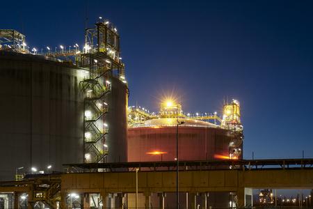 Liquefied natural gas (LNG) storage tanks at night.