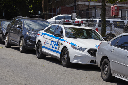 New York, USA - June 29, 2018: NYPD vehicle parked by a street on Staten Island. New York City Police Department is the largest and one of the oldest municipal police departments in the United States.