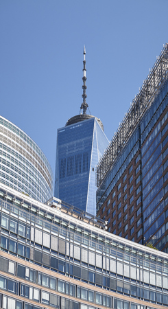 New York, USA - July 07, 2018: One World Trade Center tower spire seen from the Battery Park on a sunny day.