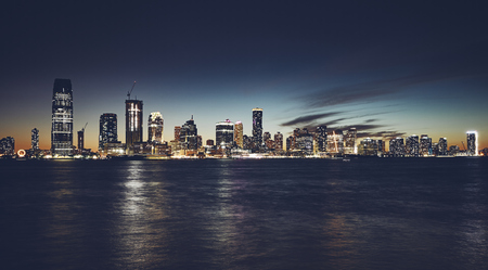 Jersey City skyline at night, color toning applied, USA.