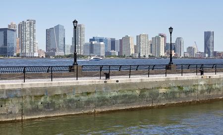 Jersey City skyline seen from Manhattan a sunny summer morning, USA.