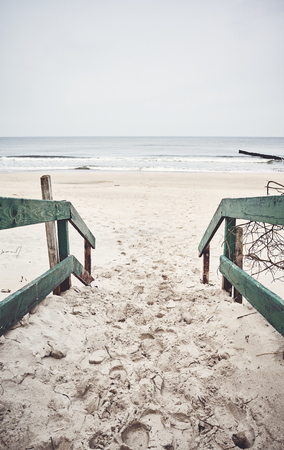 Old wooden beach entrance, color toning applied.