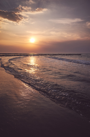 Scenic sunset over the sea, color toned picture.