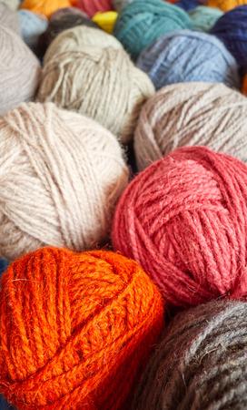 Colorful wool yarn balls, shallow depth of field.