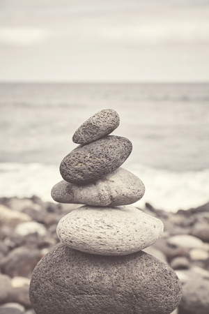 Color toned picture of a stone stack on a beach, balance and harmony concept, selective focus. Stockfoto - 122802419