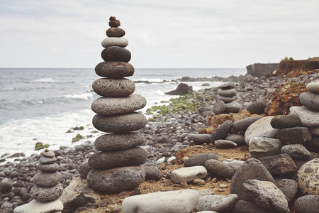 Color toned picture of a stone stack on a beach, balance and harmony concept, selective focus. Stockfoto - 122802421