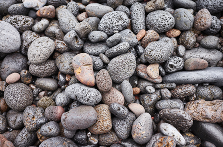 Natural background made of pebbles and volcanic rocks.
